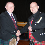 Passing the banner, retiring secretary, Brian Slack and incoming secretary Rob Newton